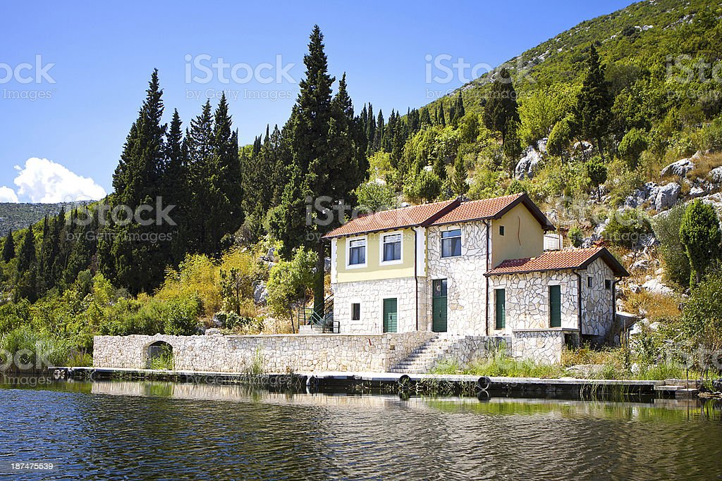 house, mountain lake stock photo