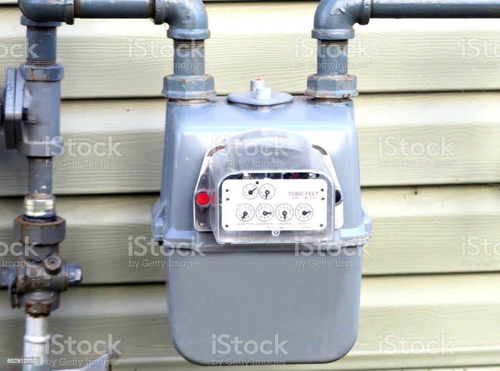 House natural gas meter readings close-up stock photo