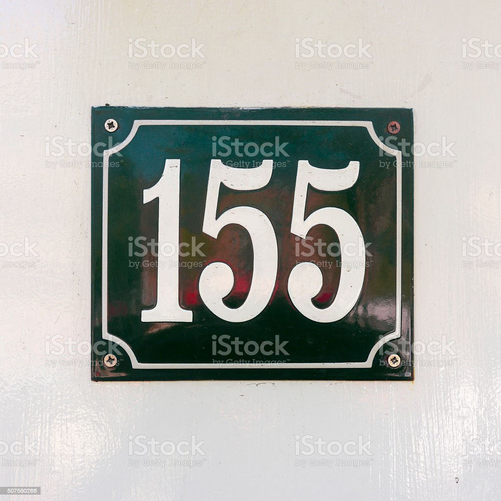 Enameled house number one hundred and fifty five. White numerals on a...
