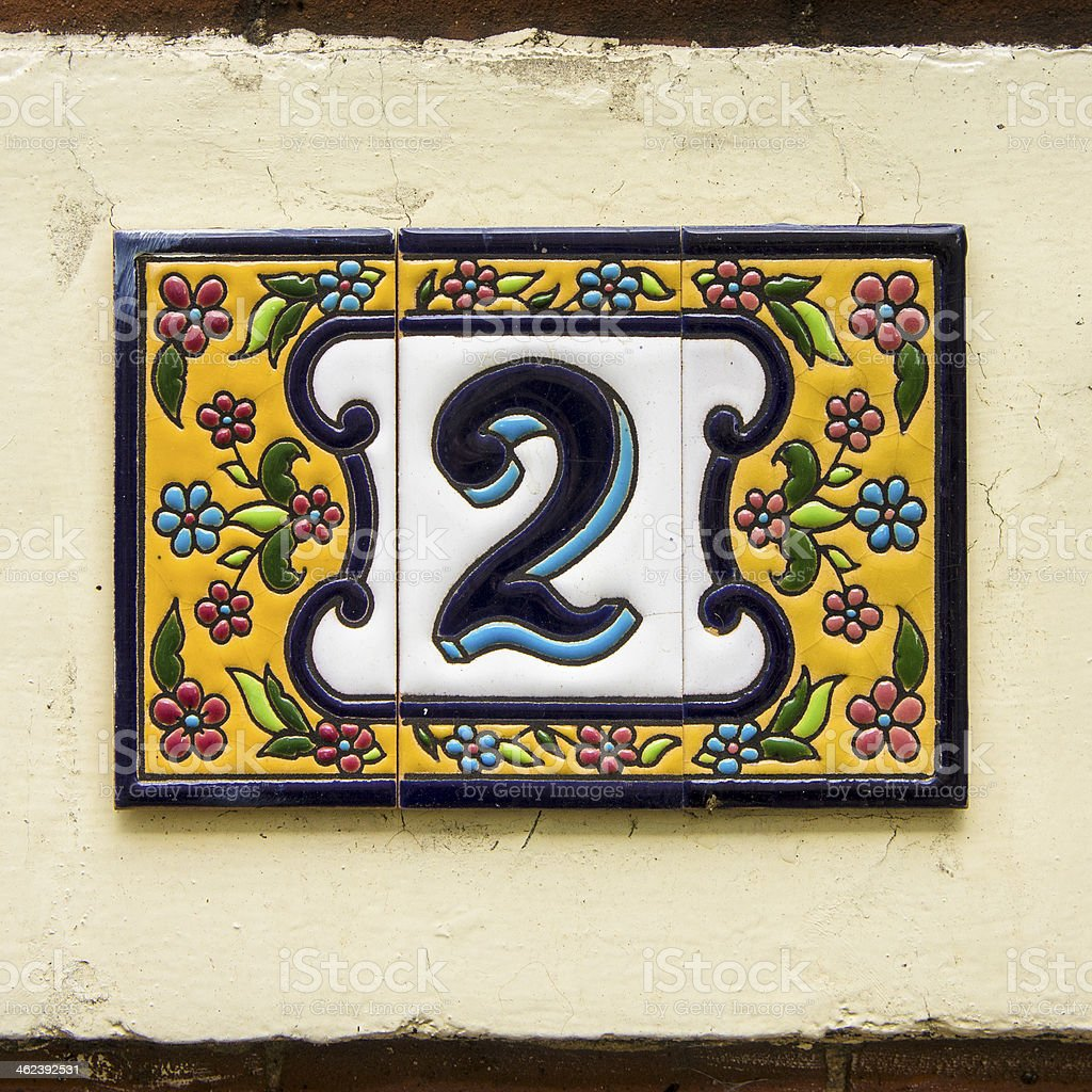 House number two, on ceramic tiles, surrounded by a flower motif