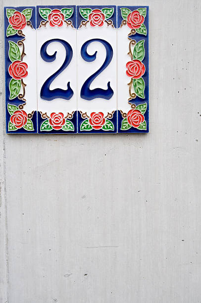 house number 22 on wall concrete stock photo