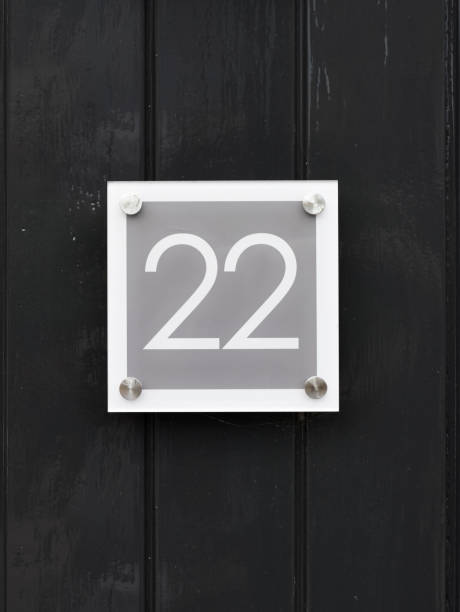 House number 22 on wooden wall happy new home moving away modern door number twenty two stock photo