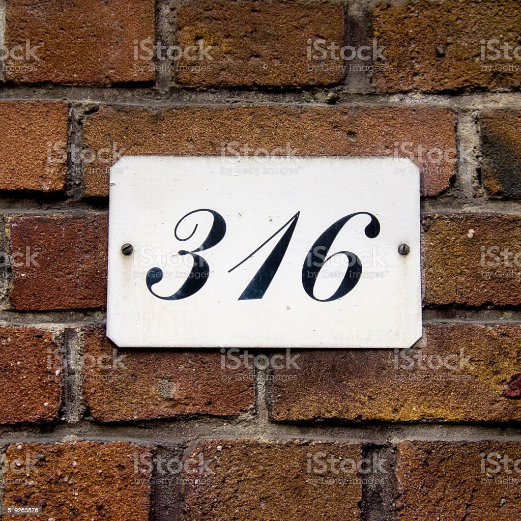 House number three hundred and sixteen. Black lettering on a white...