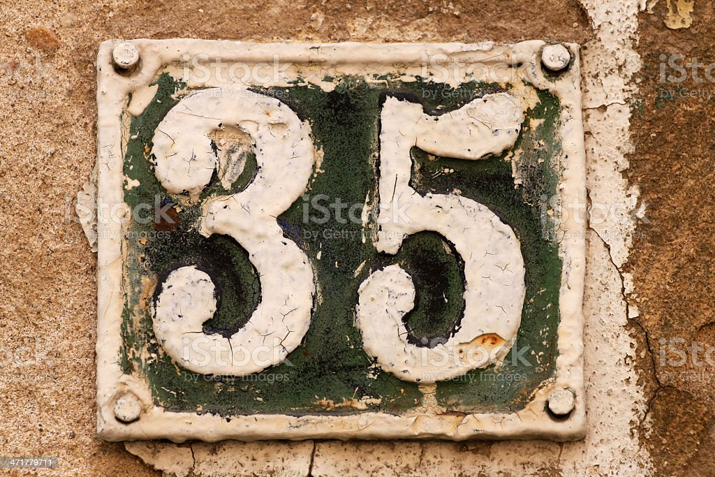House number on a wall royalty-free stock photo
