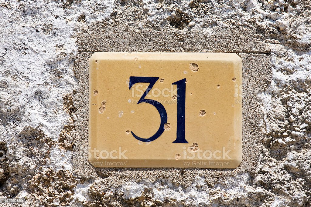 House number thirty one on old greek house.
