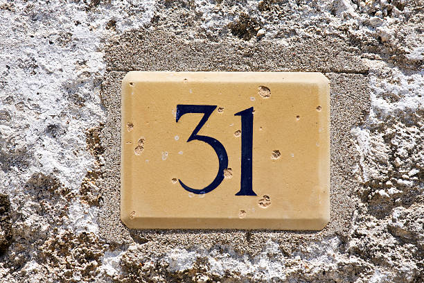 House number thirty one on old greek recidence. stock photo