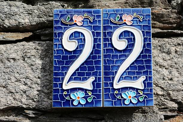 house number twenty two at old stone wall stock photo