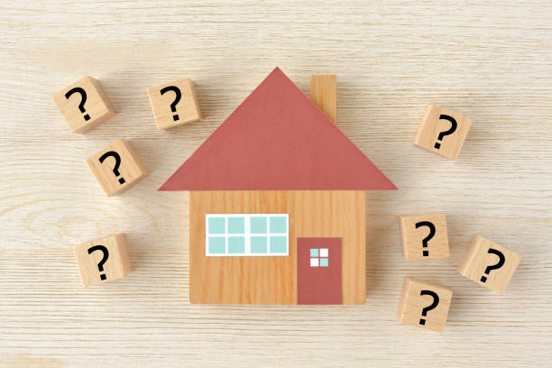 House object and wooden blocks with question mark stock photo