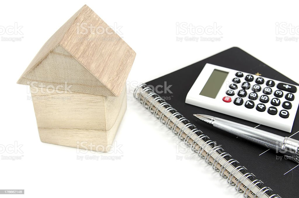 Casa de bloques, una calculadora. foto de stock libre de derechos
