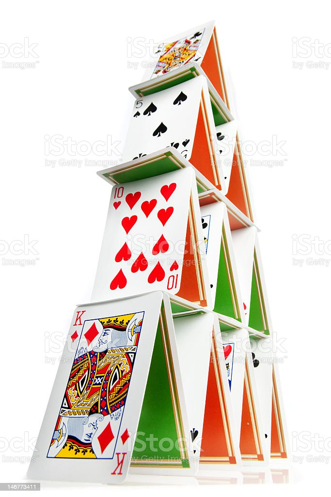 A house of cards on a white background stock photo