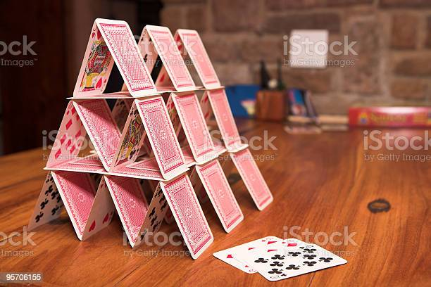 House of cards on a wooden table picture id95706155?b=1&k=6&m=95706155&s=612x612&h=w4e7pf2n2zmt6hlv8 6sb4gxhun8s00pb0il0 q dpe=