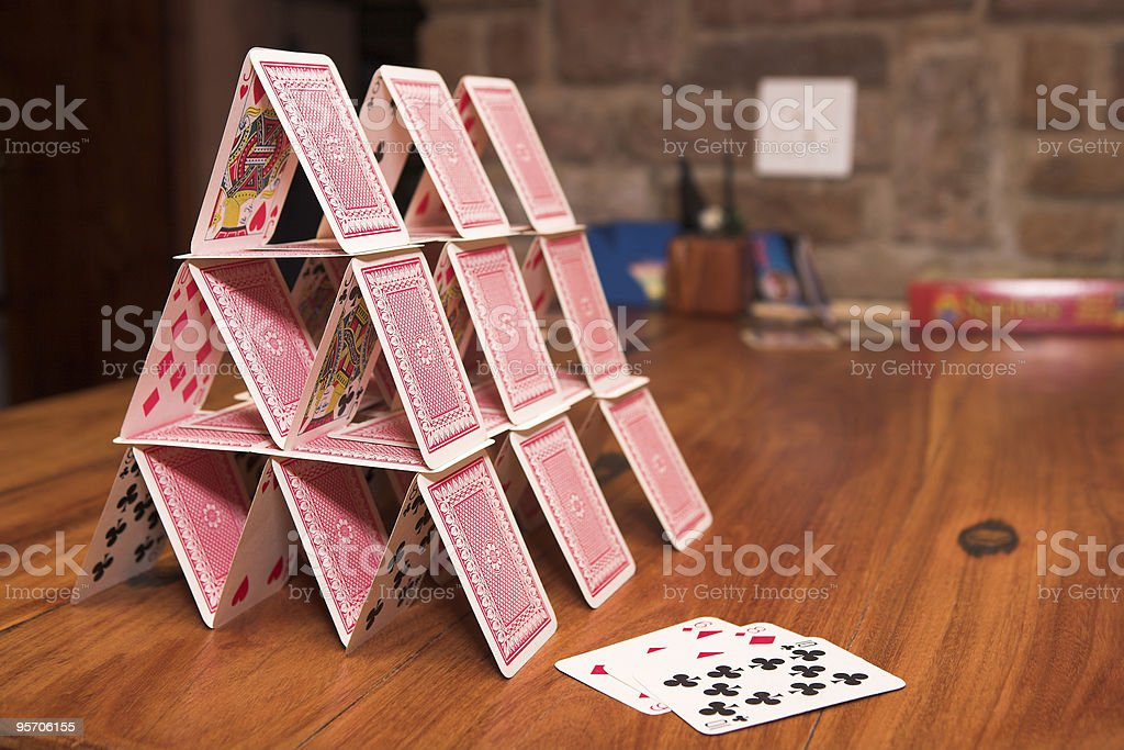 House of cards on a wooden table stock photo