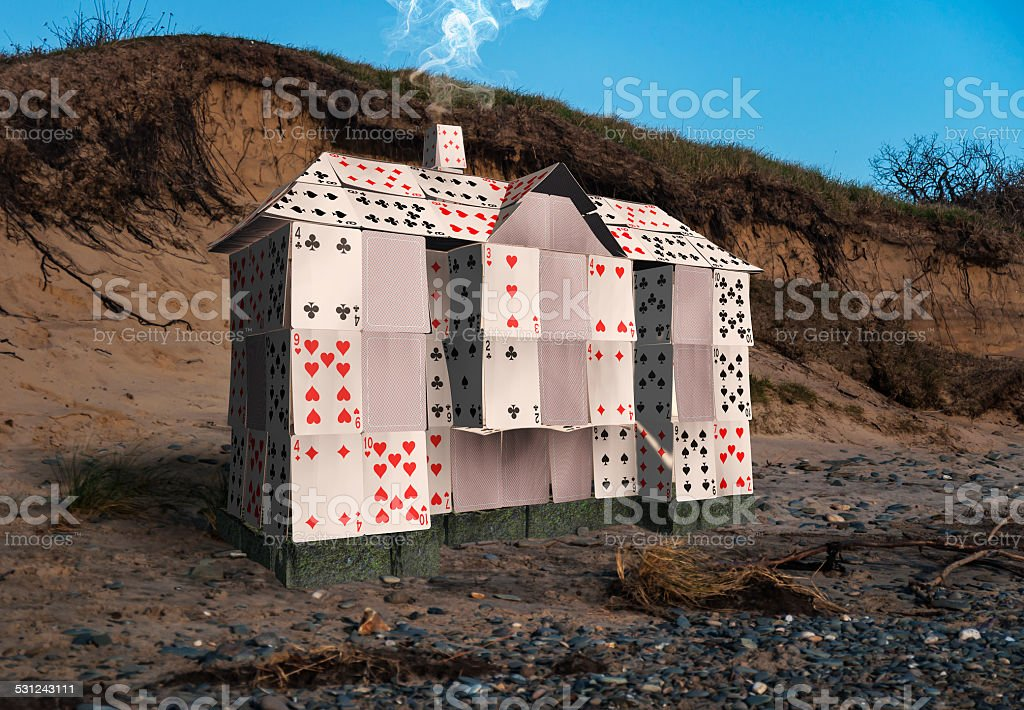 House of cards on the water's edge. stock photo