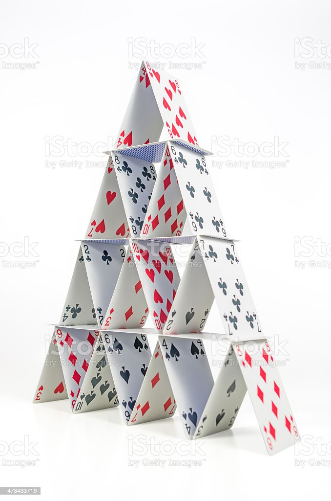 House of cards stacked in a pyramid stock photo