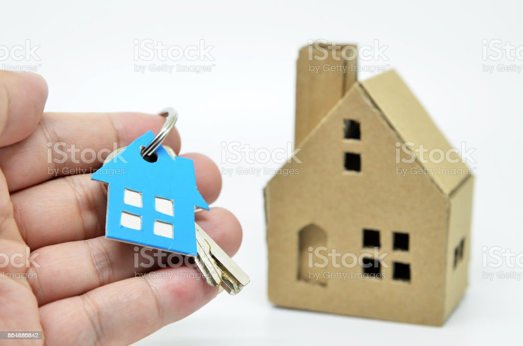 House of paper and metal key i stock photo