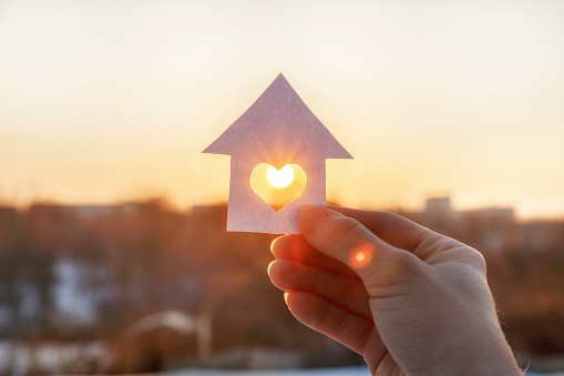 House Of Paper With A Heart In The Hand Stock Photo - Download Image Now