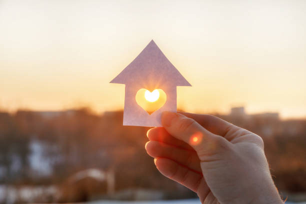 house of paper with a heart in the hand . - conceptual symbol stock pictures, royalty-free photos & images