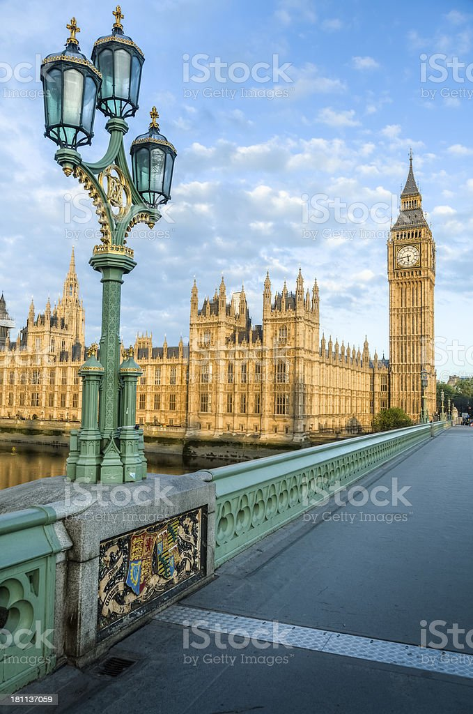 House of Parliament, Bridge with Ornate Street Lamp at Sunrise royalty-free stock photo