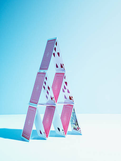 house of playing cards - fragility stock photos and pictures