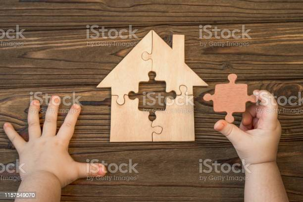 House of puzzles hands missing detail on a wooden background picture id1157549070?b=1&k=6&m=1157549070&s=612x612&h=icgw  xluzr8jkxyalngm9lw1lopyw5xxtjhl07 gjm=