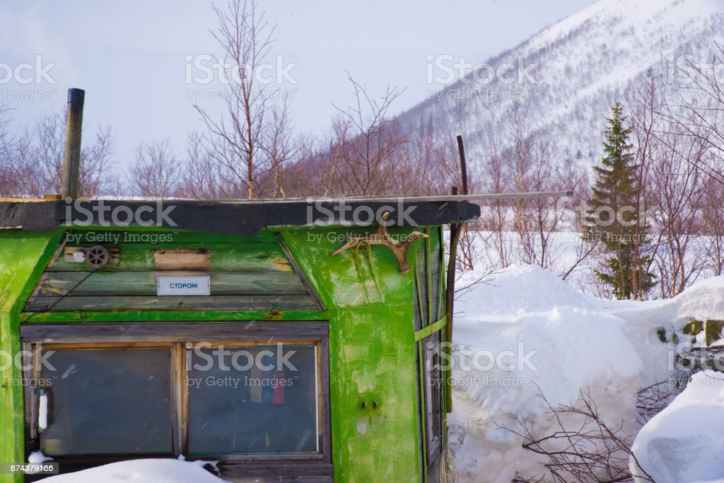 house of watchman (caretaker or guard) in winter mountains with antler.  North of Russia,  Kirovsk. stock photo