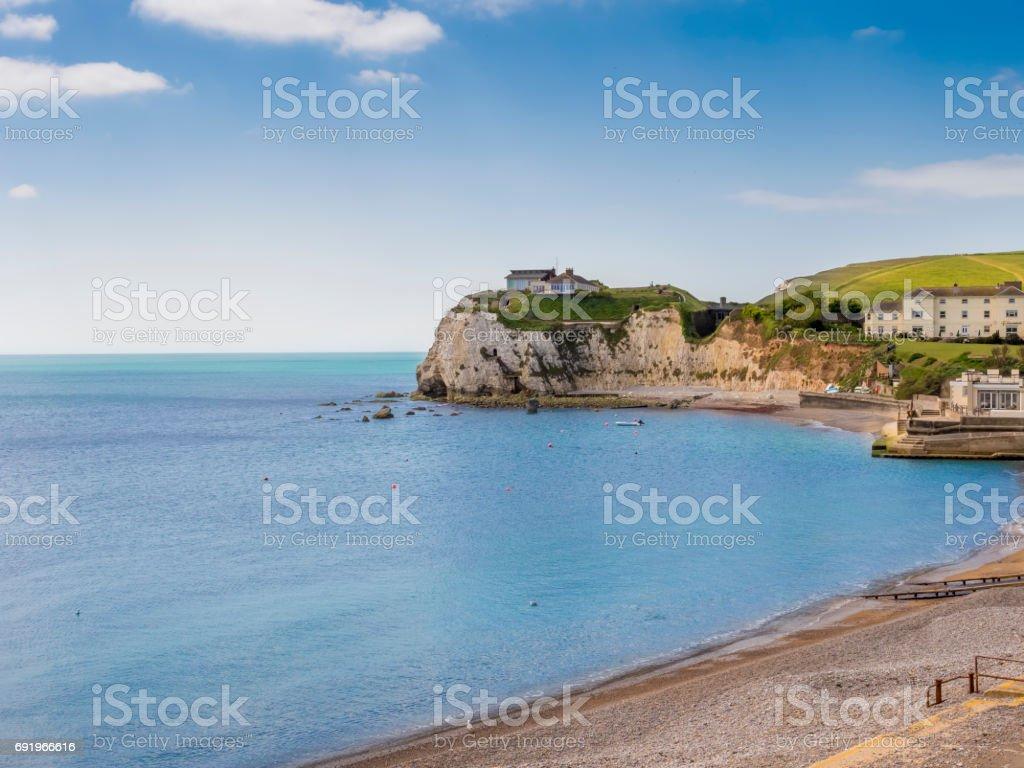 House on cliff on coast stock photo