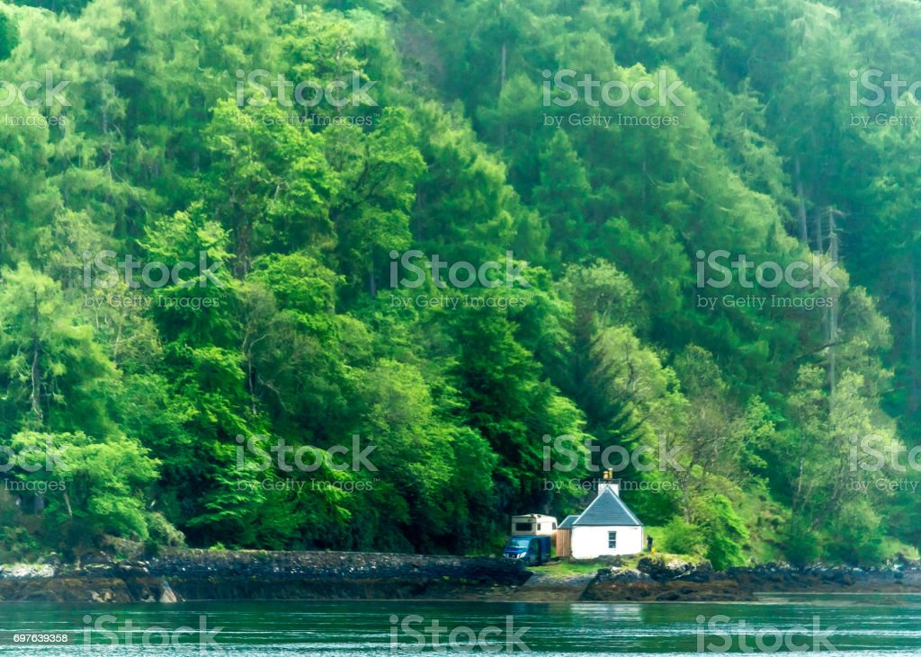 House on edge of Loch Alsh stock photo
