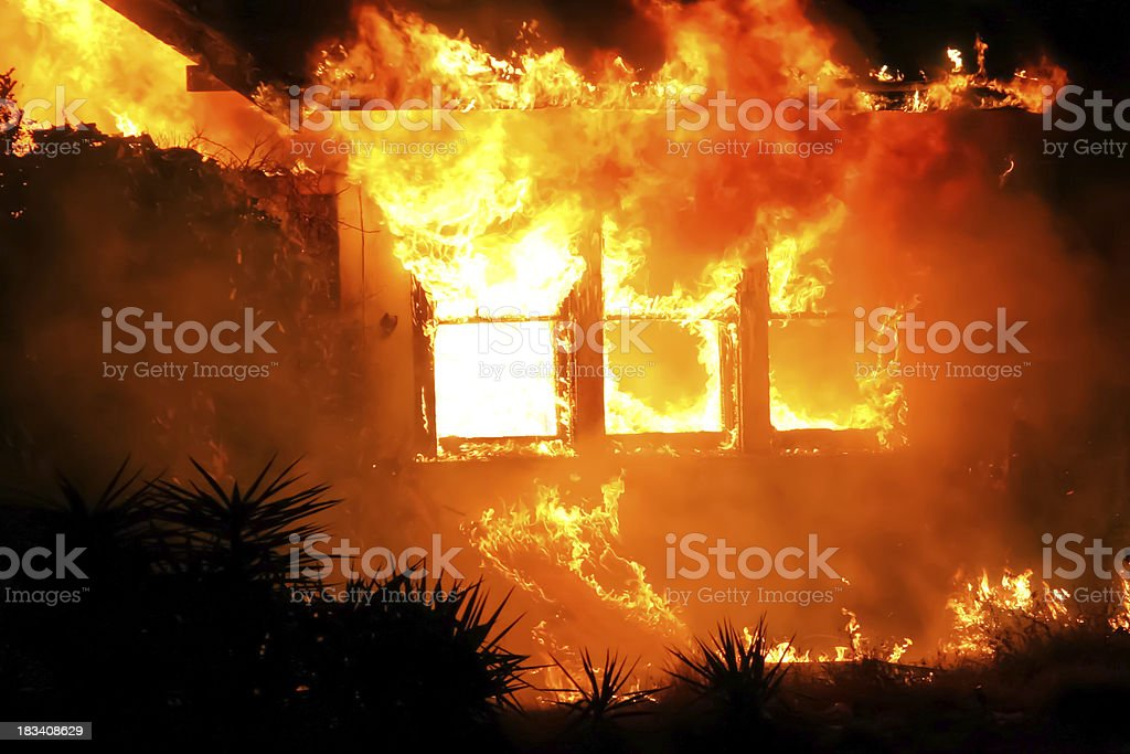 House On Fire At Night stock photo