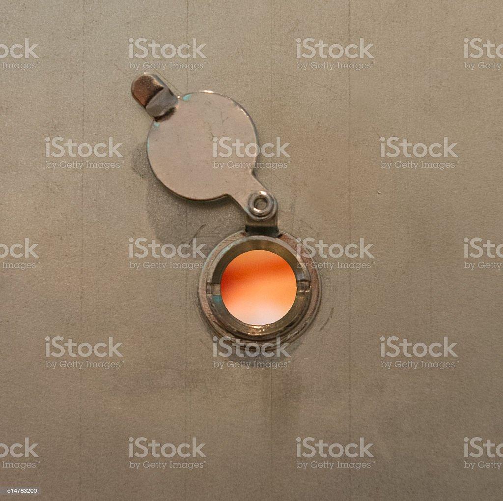 House on fire door, peephole flame stock photo