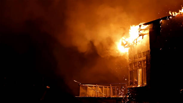 House on fire. Inferno conflagration. stock photo
