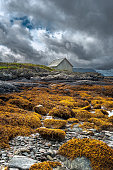 istock House on Grotlesanden beach under powerful overcast sky, Bremanger, Norway. 483148561