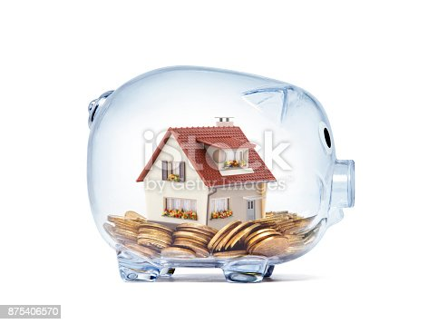 istock House on money inside transparent piggy bank with clipping path 875406570