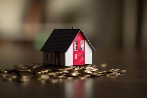 House on money stack stock photo