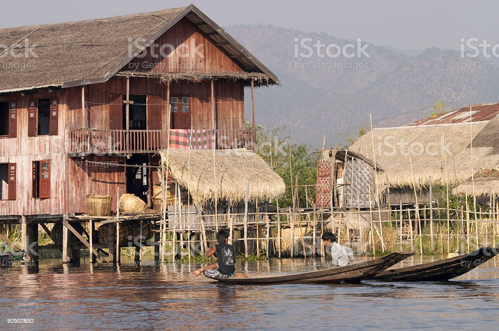 House on Stilts and Young Boys royalty-free stock photo