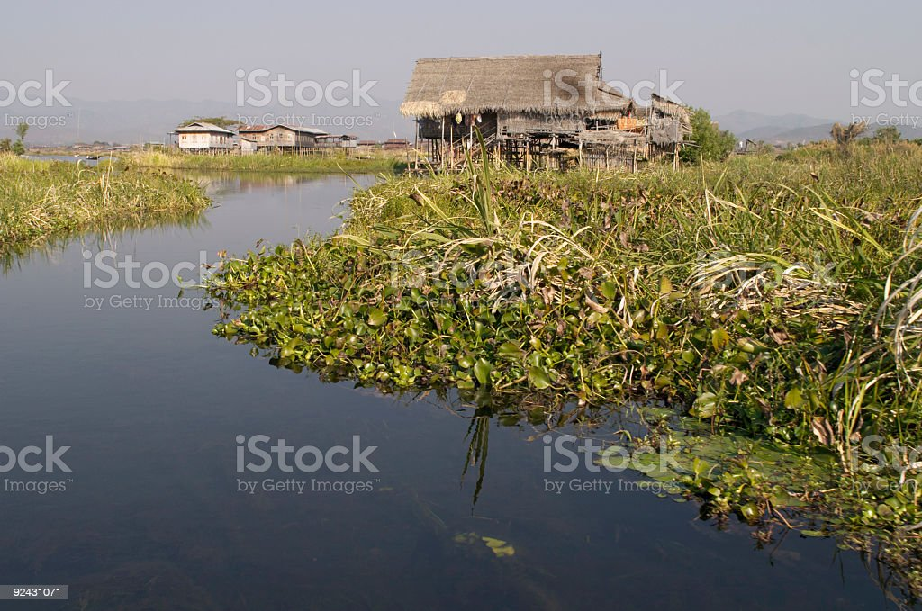 House on Stilts with Thatched Roof royalty-free stock photo