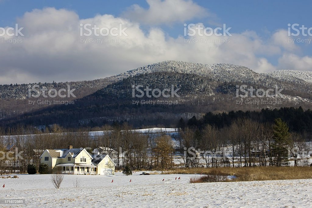 House on the base of a mountain stock photo