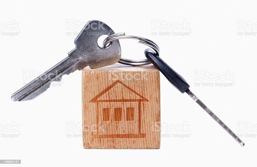 House on the old wooden cube with keys royalty-free stock photo