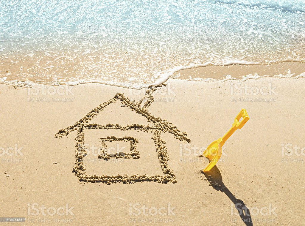 house on the sand drawing of a house on the beach - concept safety and vacation Australia Stock Photo