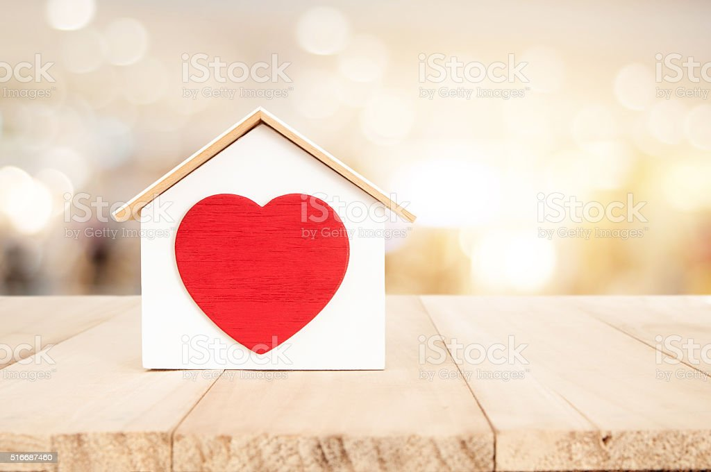 House on wooden floor , home concept stock photo
