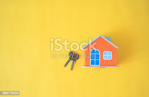 istock House on yellow background. 995779204