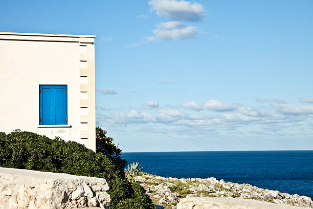 House Overhanging The Sea stock photo