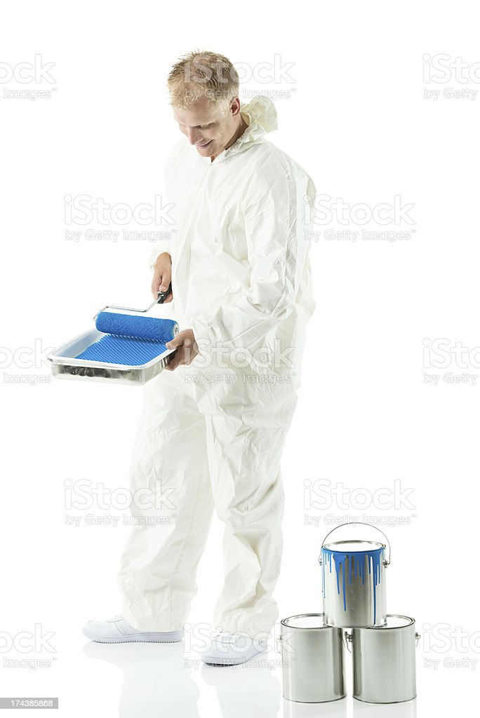 House painter at work against white stock photo
