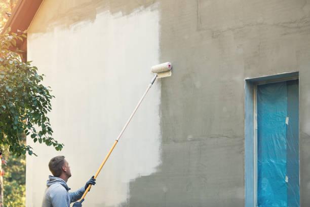 exterior do prédio de pintura do pintor com rolo - fachada - fotografias e filmes do acervo