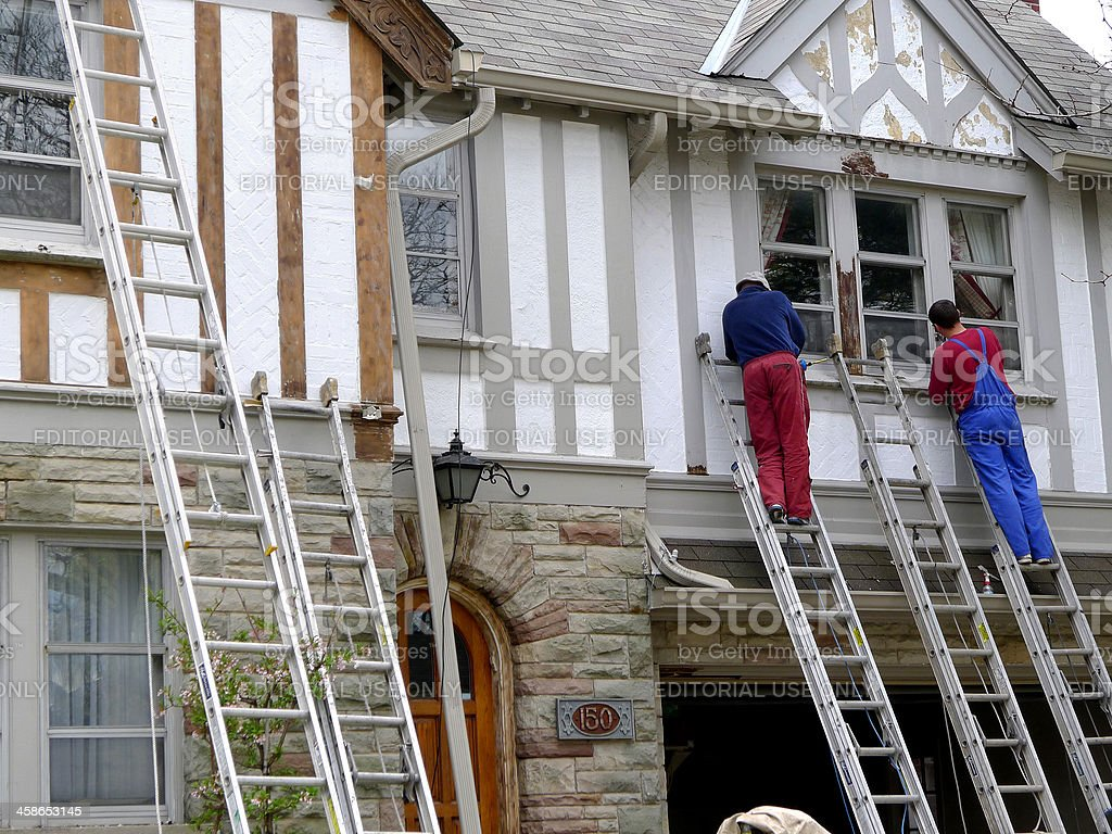 House painters on ladders stock photo