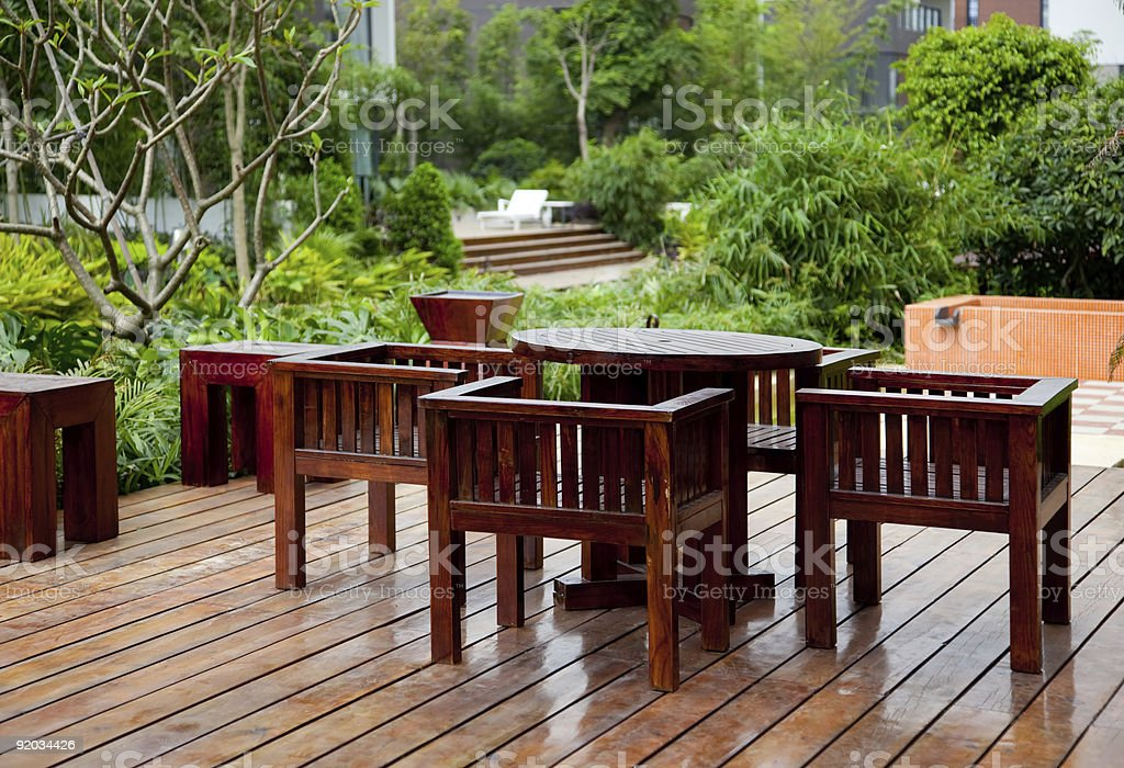 House patio with table and chairs stock photo
