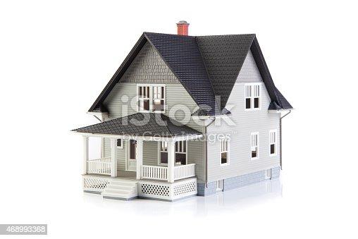 Toy house on white