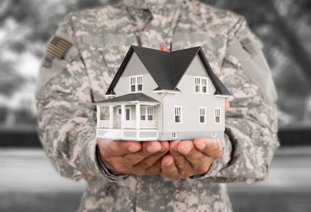 House. Man in US military uniform holding mock-up of house military lifestyle stock pictures, royalty-free photos & images