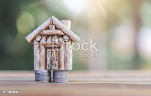 House placed on coins. Indicates saving money for home and the growth of home business. planning savings money of coins to buy a home concept for property, mortgage and real estate invest for a house.