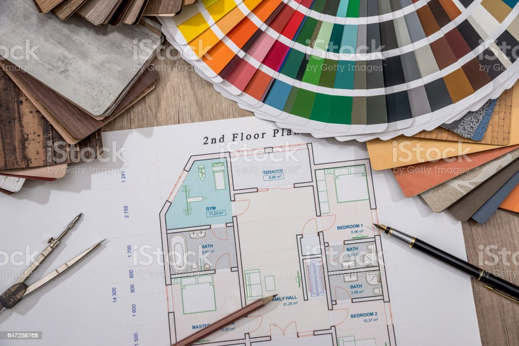 house plan with palette of colors and wooden sampler. stock photo