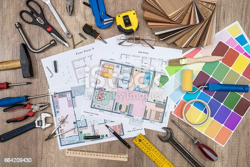 istock house plan with working tools. office work. 664209430